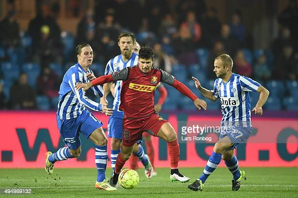 Nicki Bille Nielsen of Esbjerg fB Emiliano Marcondes of FC Nordsjalland and Robin Soeder of Esbjerg fB compete for the ball during the Danish Alka...
