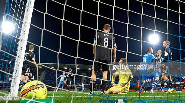 Nicki Bille Nielsen of Esbjerg fB scores the 10 goal against Goalkeeper Nicolai Larsen of AaB Aalborg during the Danish Alka Superliga match between...