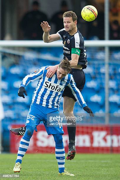 Nicki Bille of Esbjerg fB and Mads Justesen of Hobro IK compete for the ball during the Danish Alka Superliga match between Esbjerg fB and Hobo IK at...