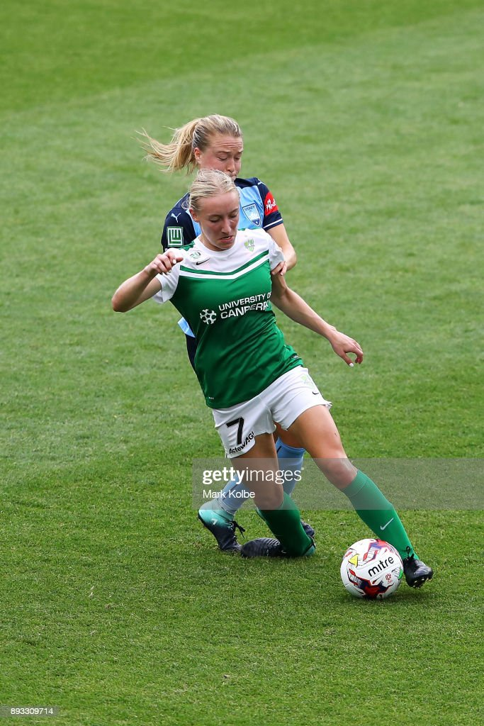 Nicki Flannery of Canberra United twists her ankle as she is tackled by Emily Sonnett of Sydney FC during the round eight W-League match between Sydney FC and Canberra United at Allianz Stadium on December 15, 2017 in Sydney, Australia.