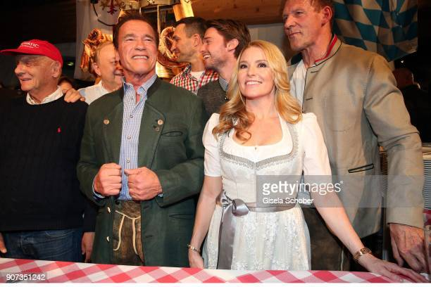 Nicki Lauda and Arnold Schwarzenegger and his girlfriend Heather Milligan during the 27th Weisswurstparty at Hotel Stanglwirt on January 19 2018 in...