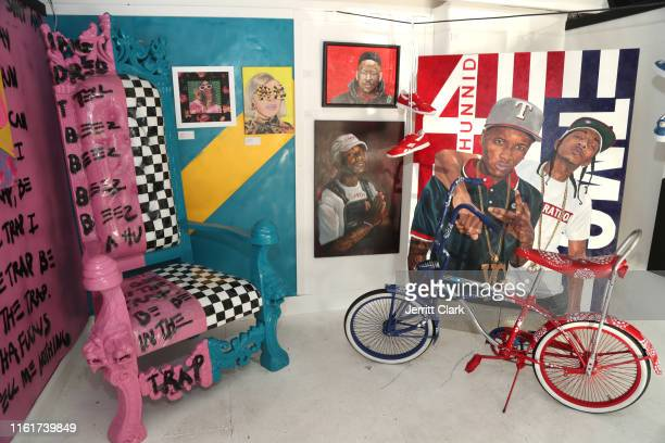 Nicki Minaj and Cardi B and YG and Nipsey Hussle inspired art installation at Lil Trap House Exhibition Launch Event at Delicious Pizza on July 12...