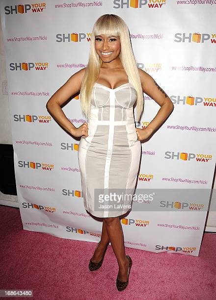 Nicki Minaj attends a sneak peak of her Kmart collection at Fig Olive Melrose Place on March 1 2013 in West Hollywood California