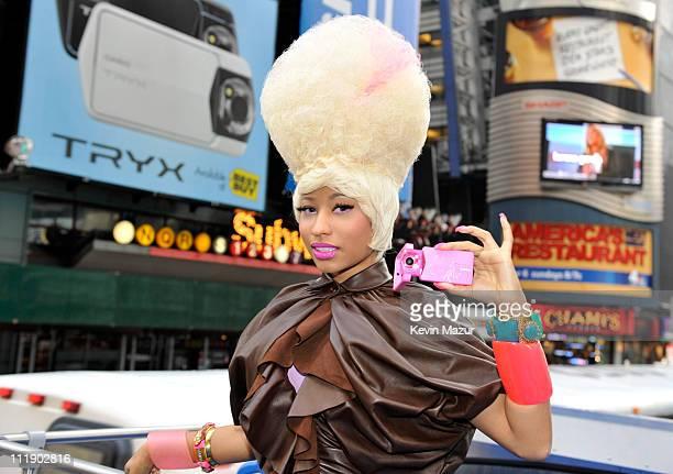 Nicki Minaj helps Casio unveil their new TRYX digital camera billboard at Times Square on April 7 2011 in New York City