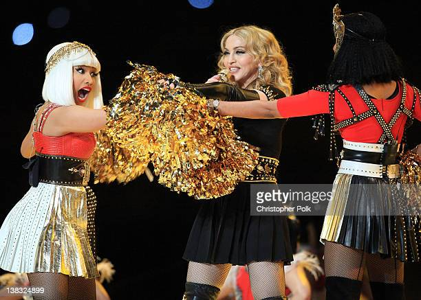 Nicki Minaj Madonna and MIA perform during the Bridgestone Super Bowl XLVI Halftime Show at Lucas Oil Stadium on February 5 2012 in Indianapolis...
