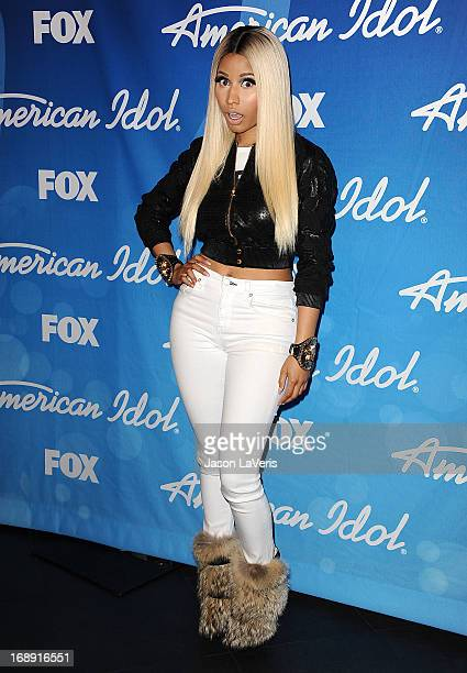 Nicki Minaj poses in the press room at the American Idol 2013 finale at Nokia Theatre LA Live on May 16 2013 in Los Angeles California
