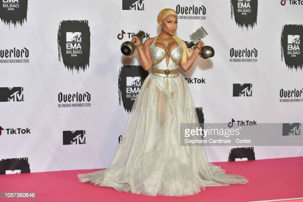 Nicki Minaj poses in the Winners room with the Best Hip Hop Award and Best Look Award during the MTV EMAs 2018 on November 4 2018 in Bilbao Spain