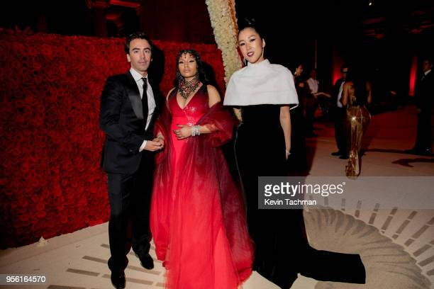 Nicki Minaj poses with designers Laura Kim and Fernando Garcia of Oscar de la Renta at Heavenly Bodies Fashion The Catholic Imagination Costume Gala...