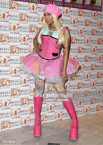 Nicki Minaj signs copies of her number one album 'Pink Friday: Roman Reloaded' at HMV Whiteleys on April 19, 2012 in London, England.