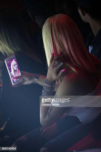 Nicki Minaj takes selphies for social media at the Philipp Plein Spring/Summer 2018 collection fashion show during New York fashion week on September...