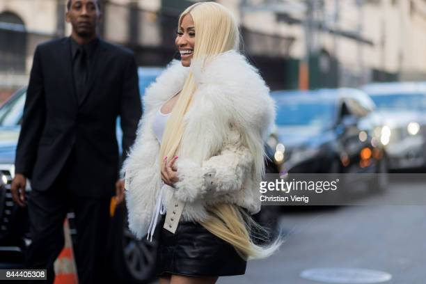 Nicki Minaj wearing a black leather skirt white top fur jacket black overknee boots seen in the streets of Manhattan outside Monse during New York...