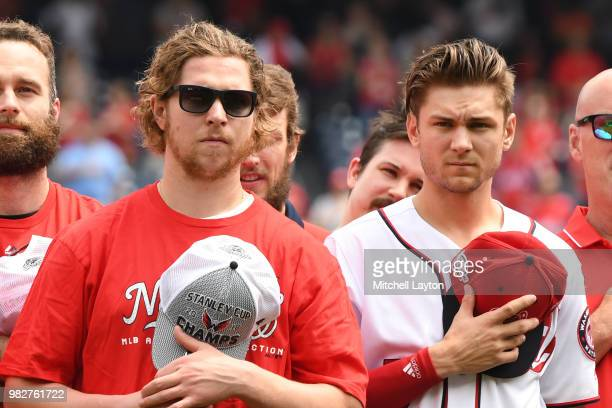 Nicklas Backstroke of the Washington Capitals and Trea Turner of the Washington Nationals stand for the National Anthem before a baseball game...