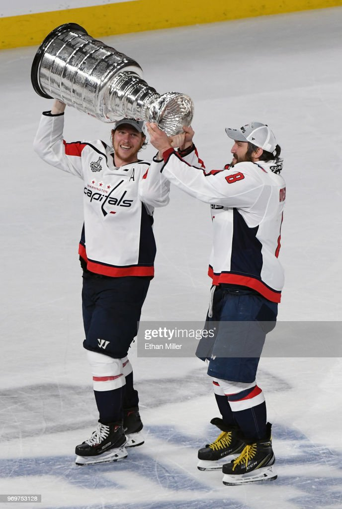 Nicklas Backstrom #19 and Alex Ovechkin #8 of the Washington Capitals skate with the Stanley Cup after the team's 4-3 win over the Vegas Golden Knights in Game Five of the 2018 NHL Stanley Cup Final at T-Mobile Arena on June 7, 2018 in Las Vegas, Nevada.