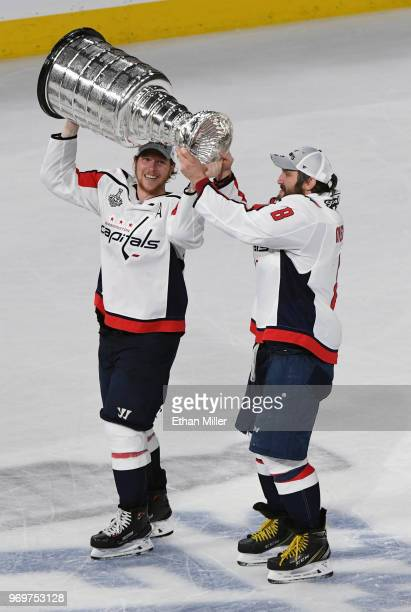 Nicklas Backstrom and Alex Ovechkin of the Washington Capitals skate with the Stanley Cup after the team's 43 win over the Vegas Golden Knights in...