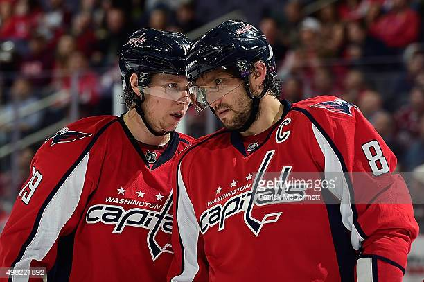 Nicklas Backstrom and Alex Ovechkin of the Washington Capitals talk before  a faceoff in the third d92bb53ae4d9