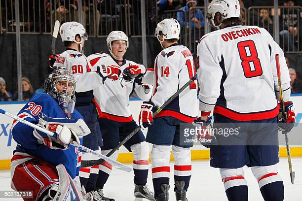 Nicklas Backstrom Justin Williams Marcus Johansson and Alex Ovechkin of the Washington Capitals celebrate after a second period goal against Henrik...