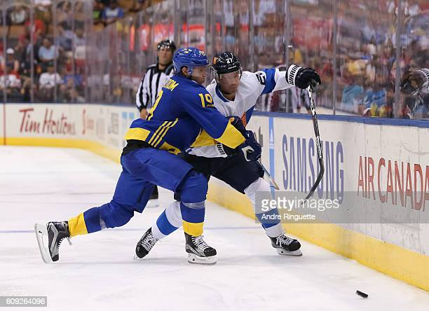 Nicklas Backstrom of Team Sweden battles for position with Joonas Donskoi of Team Finland during the World Cup of Hockey 2016 at Air Canada Centre on...