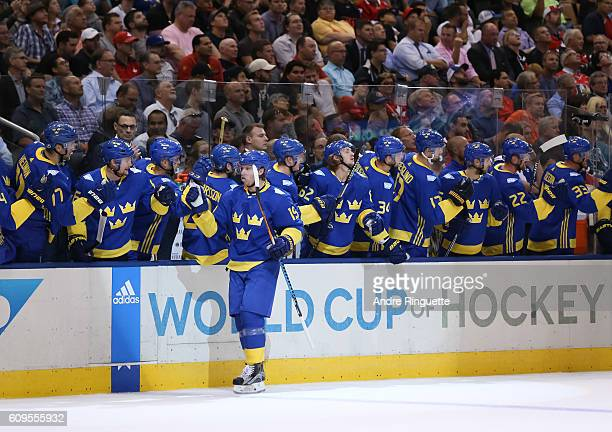 Nicklas Backstrom of Team Sweden high fives the bench after scoring a first period goal Team North America during the World Cup of Hockey 2016 at Air...