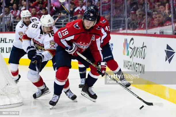 Nicklas Backstrom of the Washington Capitals and Aleksander Barkov of the Florida Panthers battle for the puck in the third period at Capital One...