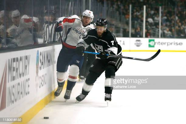Nicklas Backstrom of the Washington Capitals and Oscar Fantenberg of the Los Angeles Kings fight for control of the puck during the first period at...