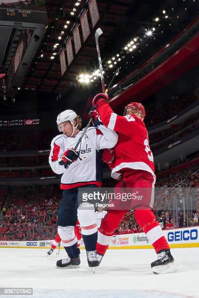 Nicklas Backstrom of the Washington Capitals battles for position with Trevor Daley of the Detroit Red Wings during an NHL game at Little Caesars...