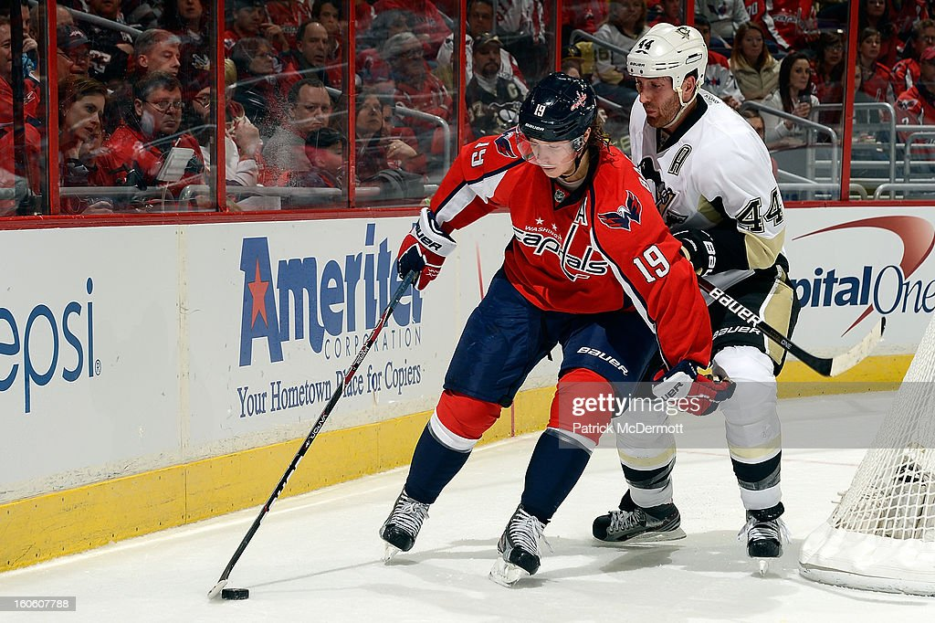 Nicklas Backstrom #19 of the Washington Capitals battles for the puck against Brooks Orpik #44 of the Pittsburgh Penguins during an NHL game at Verizon Center on February 3, 2013 in Washington, DC.