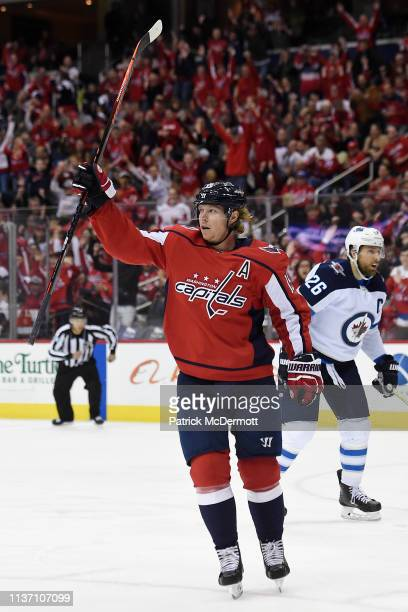 Nicklas Backstrom of the Washington Capitals celebrates after scoring a goal against the Winnipeg Jets in the first period at Capital One Arena on...