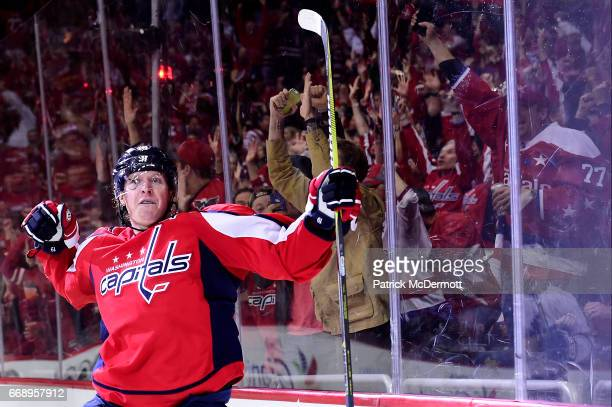 Nicklas Backstrom of the Washington Capitals celebrates after scoring a goal against the Toronto Maple Leafs in the third period in Game Two of the...