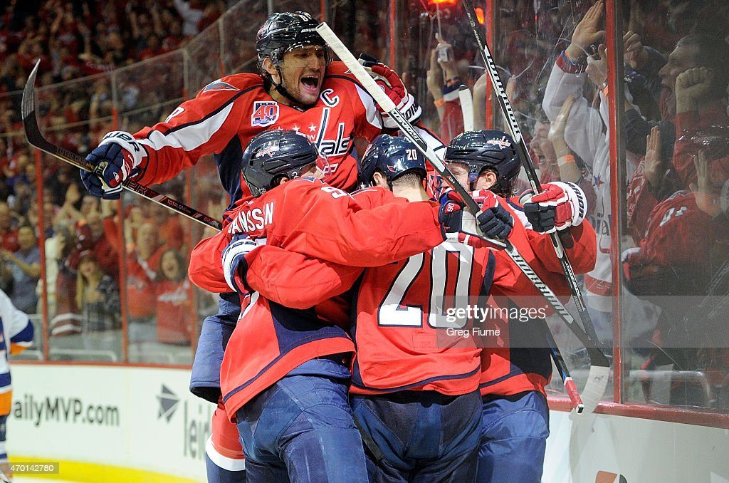 Nicklas Backstrom #19 of the Washington Capitals celebrates with teammates after scoring in the third period against the New York Islanders during Game Two of the Eastern Conference Quarterfinals during the 2015 NHL Stanley Cup Playoffs at Verizon Center on April 17, 2015 in Washington, DC. Washington won the game 4-3.