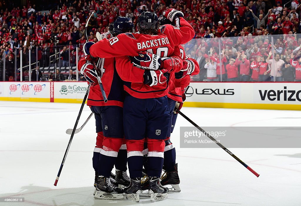 Nicklas Backstrom #19 of the Washington Capitals celebrates with his teammates after scoring a goal against the Dallas Stars in the first period during an NHL game at Verizon Center on November 19, 2015 in Washington, DC.