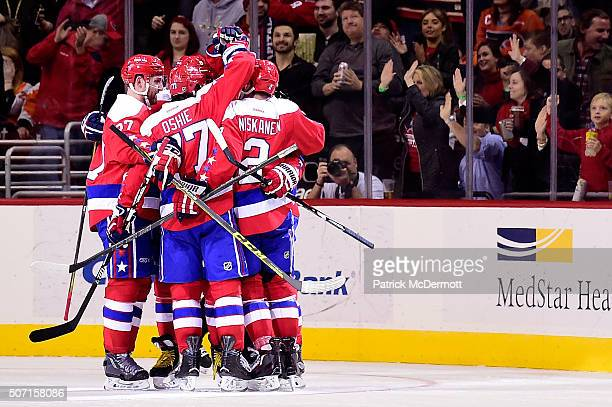 Nicklas Backstrom of the Washington Capitals celebrates with his teammates after scoring a goal against the Philadelphia Flyers in the second period...