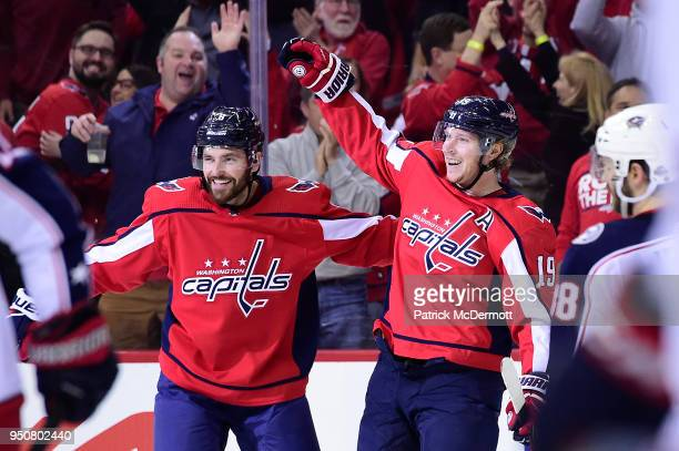 Nicklas Backstrom of the Washington Capitals celebrates with Michal Kempny after scoring a first period goal against the Columbus Blue Jackets in...