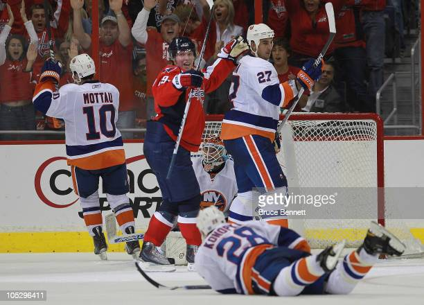 Nicklas Backstrom of the Washington Capitals celebrtaes the third period game winning goal by Alex Ovechkin against the New York Islanders at the...