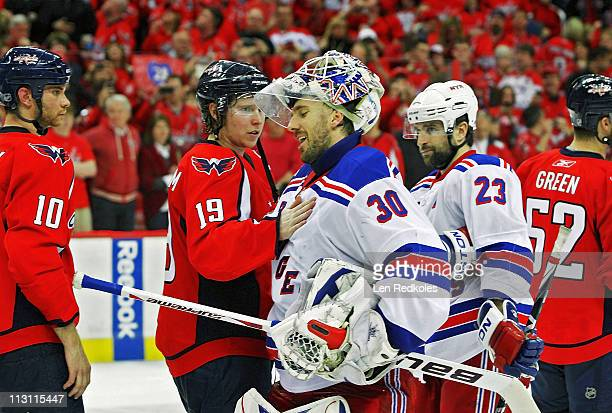 Nicklas Backstrom of the Washington Capitals consoles fellow countrymen Henrik Lundqvist of the New York Rangers during the handshake following a 31...