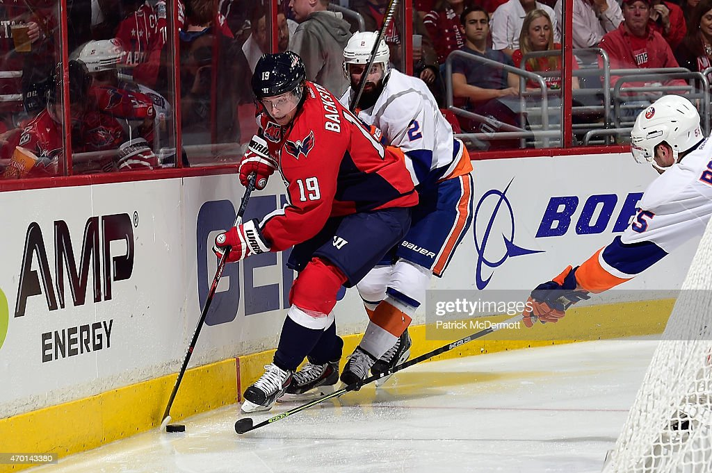 Nicklas Backstrom #19 of the Washington Capitals controls the puck behind the net against Nick Leddy #2 of the New York Islanders during the first period in Game Two of the Eastern Conference Quarterfinals during the 2015 NHL Stanley Cup Playoffs at Verizon Center on April 17, 2015 in Washington, DC.