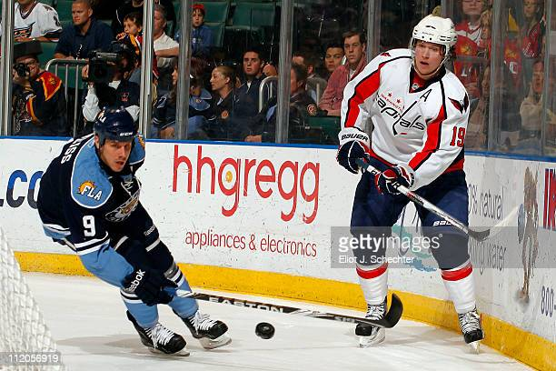Nicklas Backstrom of the Washington Capitals digs the puck out from the boards against Stephen Weiss of the Florida Panthers at the BankAtlantic...