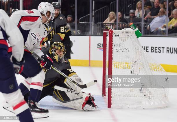 Nicklas Backstrom of the Washington Capitals gets past goaltender MarcAndre Fleury of the Vegas Golden Knights to score a goal during the first...
