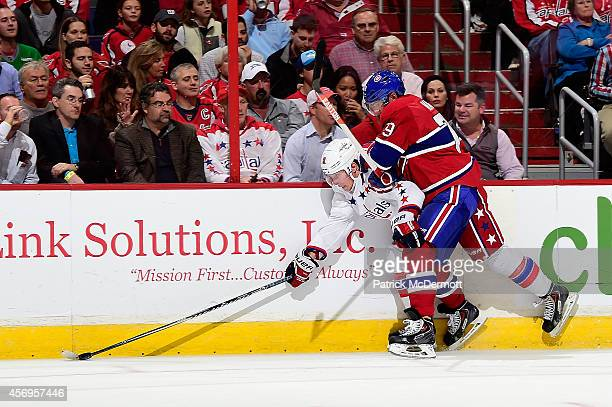 Nicklas Backstrom of the Washington Capitals is checked against the boards by Andrei Markov of the Montreal Canadiens in the second period during the...