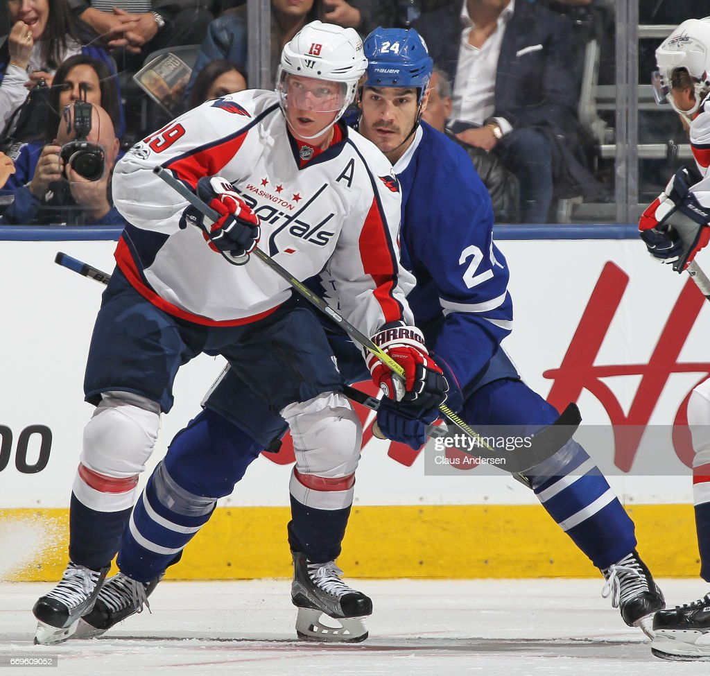 Nicklas Backstrom #19 of the Washington Capitals is held up by Brian Boyle #24 of the Toronto Maple Leafs in Game Three of the Eastern Conference Quarterfinals during the 2017 NHL Stanley Cup Playoffs at the Air Canada Centre on April 17, 2017 in Toronto, Ontario, Canada. The Maple Leafs defeated the Capitals 4-3 in overtime.