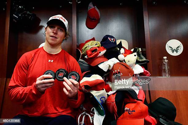 Nicklas Backstrom of the Washington Capitals poses with pucks commemorating his first regular season hat trick after an NHL game against the Tampa...