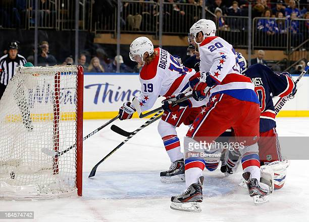 Nicklas Backstrom of the Washington Capitals scores a goal as teammate Troy Brouwer watches as goalie Henrik Lundqvist of the New York Rangers is...