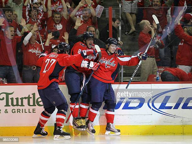 Nicklas Backstrom of the Washington Capitals scores in overtime and is joined by Mike Knuble and Alex Ovechkin to defeat the Montreal Canadiens 65 in...