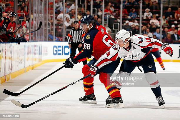 Nicklas Backstrom of the Washington Capitals skates for possession against Jaromir Jagr of the Florida Panthers at the BB&T Center on December 10,...