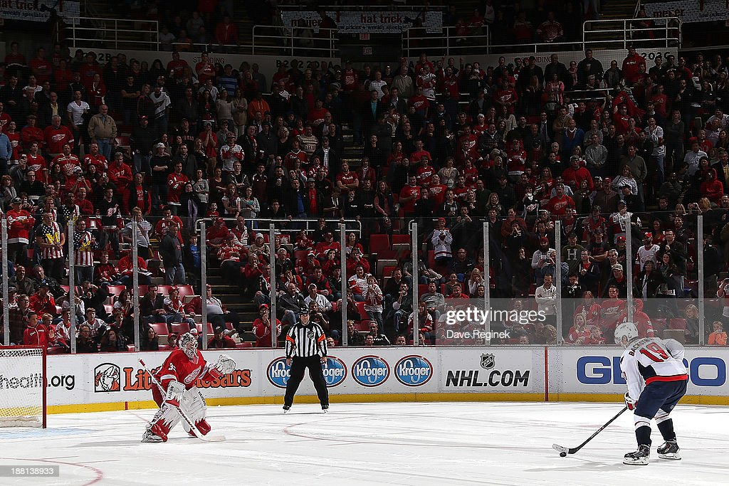 Nicklas Backstrom #19 of the Washington Capitals skates in on Jimmy Howard #35 of the Detroit Red Wings in a shootout during an NHL game at Joe Louis Arena on November 15, 2013 in Detroit, Michigan. The Capitals defeated the Wings 4-3 in a shootout.