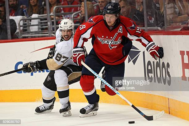 Nicklas Backstrom of the Washington Capitals skates past Sidney Crosby of the Pittsburgh Penguins during the third period in Game Five of the Eastern...