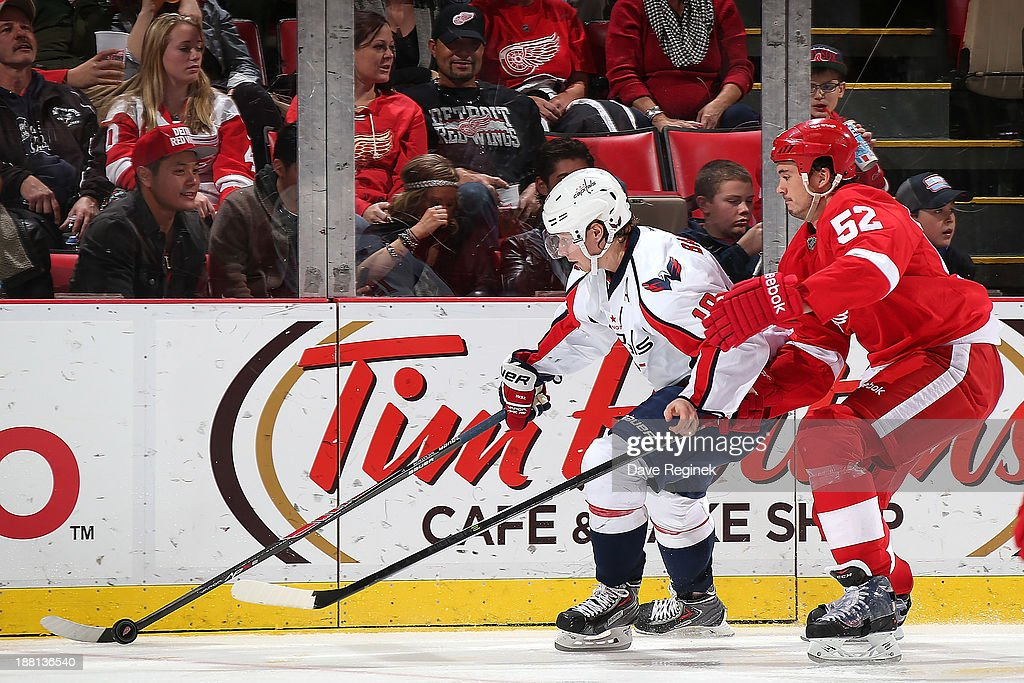 Nicklas Backstrom #19 of the Washington Capitals skates with the puck as Jonathan Ericsson #52 of the Detroit Red Wings puts on pressure during an NHL game at Joe Louis Arena on November 15, 2013 in Detroit, Michigan.