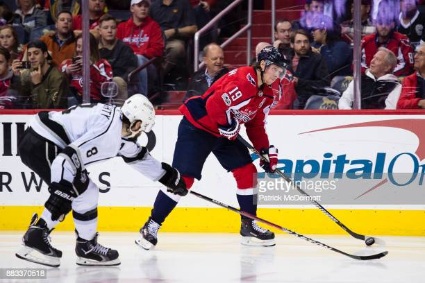 Nicklas Backstrom of the Washington Capitals skates with the puck against Drew Doughty of the Los Angeles Kings in the third period at Capital One...