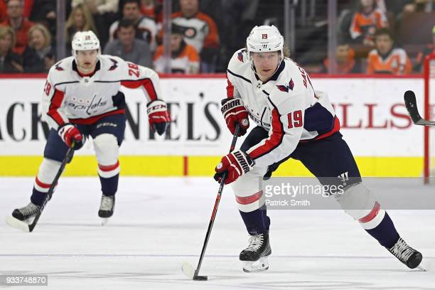 Nicklas Backstrom of the Washington Capitals skates with the puck against the Philadelphia Flyers during the first period at Wells Fargo Center on...