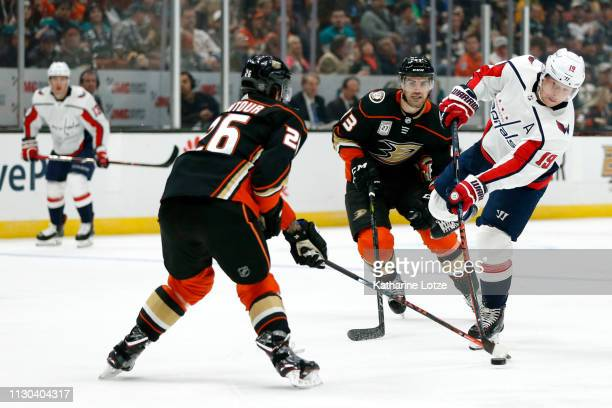 Nicklas Backstrom of the Washington Capitals takes a shot on goal as Brandon Montour of the Anaheim Ducks looks to block during the second period at...
