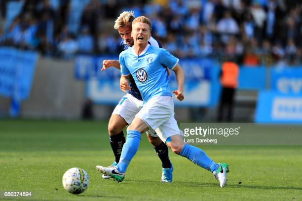 Nicklas Barkroth of IFK Norrkoping and Anders Christiansen of Malmo FF during the Allsvenskan match between Malmo FF and IFK Norrkoping at Swedbank...